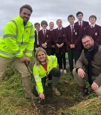 County firm puts down roots through tree planting project